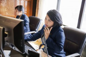 Female concierges working at their desk